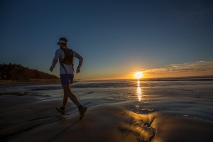 Jez Bragg runs along the Orati Beach  in the his 50 days traverse of the Te Araroa trail in New Zeland on February 2nd 2013.