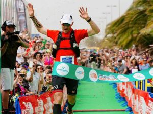 Gediminas Grinius crossing the finish line in Meloneras. Photo: Transgrancanaria
